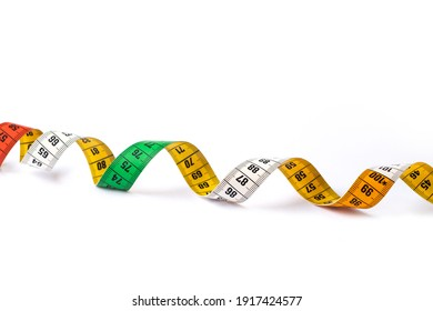 Colorful measuring tape on white background. Multicolor spiral tape measure. Empty copy space.