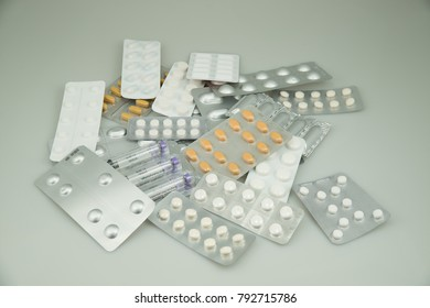 Colorful medications with insulin and suppositories on a light background