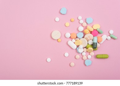 colorful medicine. Pharmacy on pink background.