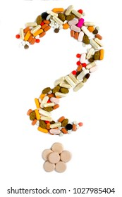 Colorful medicine tablets ,pills, vitamins or supplements folded in the form of a question mark on white background.