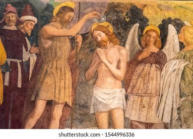 Colorful medieval fresco showing Jesus´ baptism