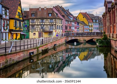 Colorful medieval half-timbered facades reflecting in water, Colmar, Alsace, France