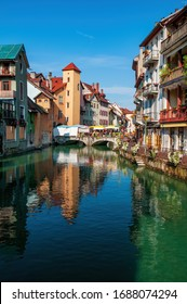Colorful medieval houses reflected in water of the canal in Annecy, France. Annecy is known as the Venice of the Alps