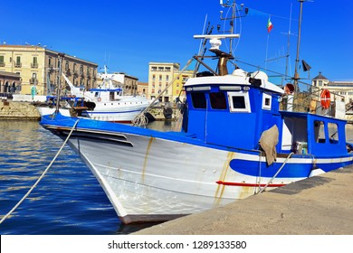 Colorful Mediterranean Commercial fishing boats at dock in Siracusa Sicily
