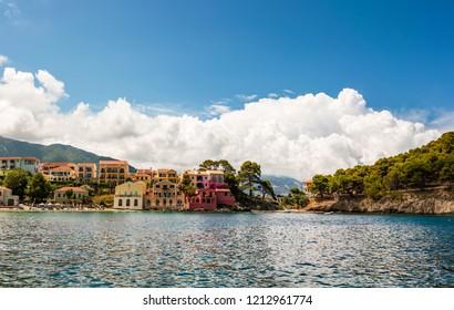 Colorful mediterranean houses on beach in Assos village, Kefalonia island, Greece.