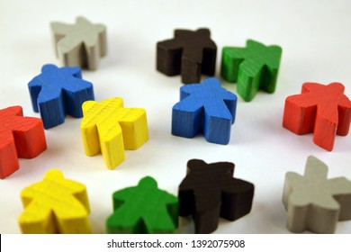 Colorful meeples on white background