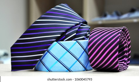 Colorful men's tie collection.Display of different patterns and colours of man ties in a shop or showroom