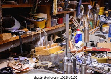 Colorful mess with various tools on a smith table in a workshop