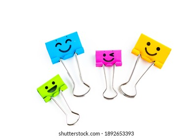 Colorful metal binders with smiles isolated on a white background, selective focus and soft focus