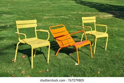colorful metal chairs in the garden