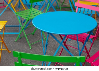 Colorful metallic table and chairs. Cafe furniture. Outdoor decoration