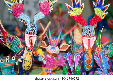 Colorful Mexican alebrijes for sale at a local street market, January 2009, Mexico City, Mexico: Alebrijes are brightly colored Mexican folk art sculptures of fantastical  and mythical creatures.