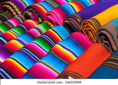 Colorful Mexican blankets for sale at market, Latin America. Mexico travel background.