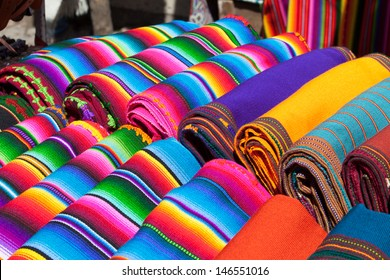 Colorful Mexican blankets for sale at market