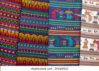 Colorful Mexican blankets souvenirs for sale at market, Latin America