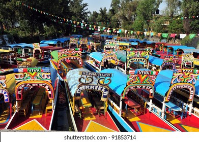 Colorful Mexican gondolas at Xochimilco's Floating Gardens in Mexico City.
