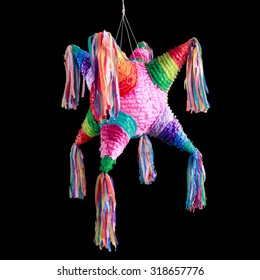 Colorful mexican pinata used in birthdays isolated on black