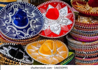 Colorful Mexican sombrero souvenirs for sale in Yucatan, Riviera Maya, Latin America. Mexico travel background.