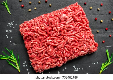 Colorful mince meat from angus wagyu beef against black background