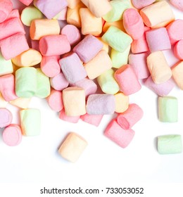 Colorful mini marshmallows isolated on white background, macro. Fluffy marshmallows texture and pattern. High Resolution image