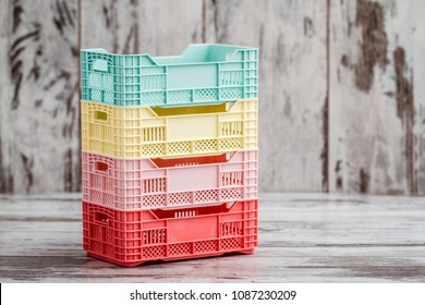 Colorful mini plastic cases on white wooden background