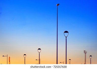 Colorful minimal Composition  with various Street Lamps at Sunset