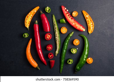 Colorful mix of chili pappers on black background.