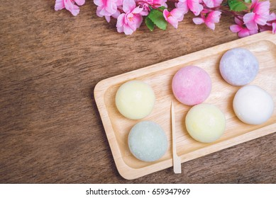 The colorful mochi dessert ice cream on wood plate ,Close Up photo with selective focus.