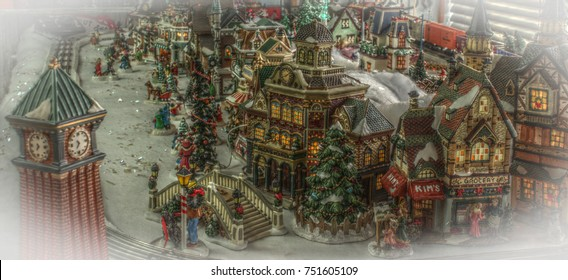 Colorful model Chrismas town with snow, clocktower and train