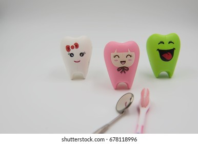colorful model Cute toys teeth in dentistry on a white background.