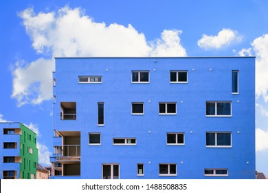Colorful Modern residential apartment and flat building exterior in Salzburg, Austria. New luxury house and home complex of blue color. City Real estate property and condo architecture. Blue sky