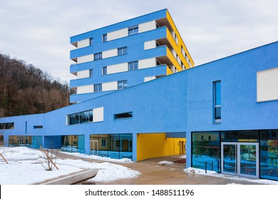 Colorful Modern residential apartment and flat building exterior in Salzburg, in Austria. New luxury house and home complex of blue color. City Real estate property and condo architecture.