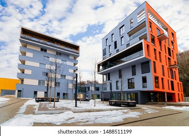 Colorful Modern residential apartment and flat building exterior, in Salzburg, Austria. New luxury house and home complex of blue and red color. City Real estate property and condo architecture.
