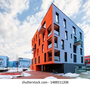 Colorful Modern residential apartment with flat building exterior in Salzburg, Austria. New luxury house and home complex of blue and red color. City Real estate property and condo architecture.