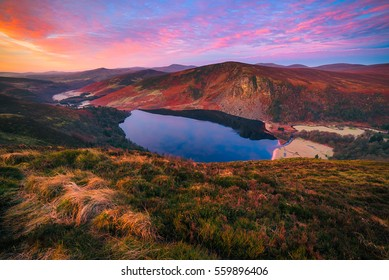 Colorful morning at Lough Tay in Wicklow Moutanis, Ireland/ Sunrise colors/  Magical color at sunrise on Lough Tay lake in Wicklow Mountains - Ireland