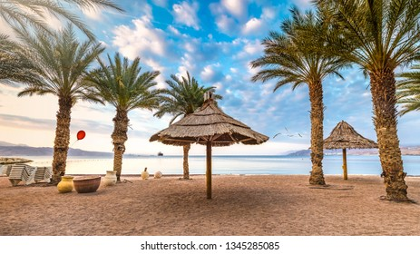 Colorful morning and sunrise on sandy beach of Eilat - famous resort and recreation city in Israel