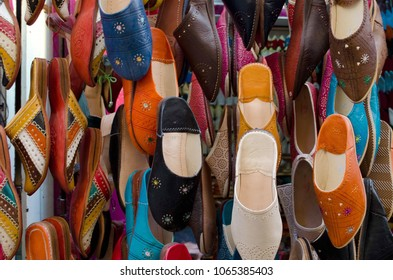 Colorful moroccan babouche shoe slippers in a shelf.