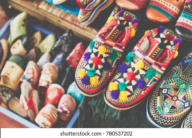 Colorful Moroccan shoes alignment in a shop. Oriental shoes in a bazaar. Multicolored Moroccan slippers. Colorful leather slippers for sale in the souk in Marrakech.