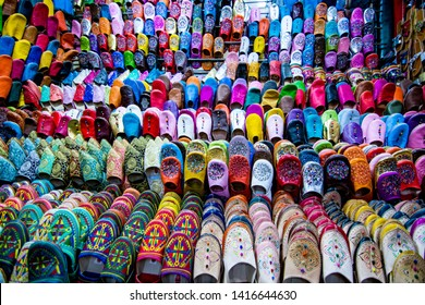 Colorful moroccan slippers - traditional leather babouches at old medina souk in Marrakech, Morocco