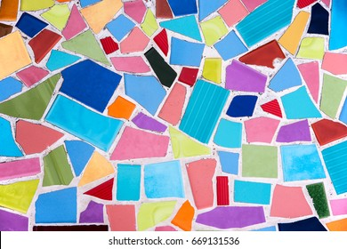 Colorful mosaic from broken tile and stone decorating on the wall for abstract background