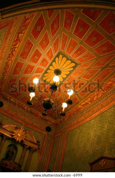 colorful mosaic ceiling lit by chandelier