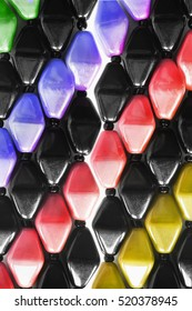 Colorful mosaic plastic beads as a background
