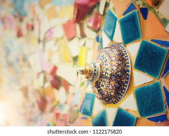 Colorful mosaic and Thai benjarong lid bowl decoration on wall texture background