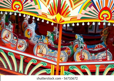 colorful motorcycle themed fairground ride