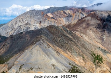 Colorful mountains in the clouds in Kluane National Park, Yukon, Canada