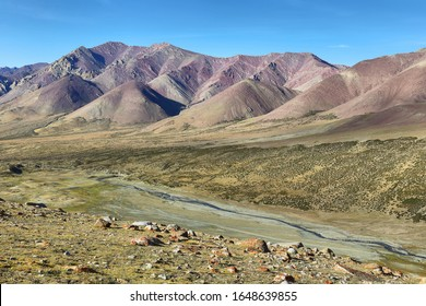 Colorful mountains and river in Hemis national park along Markha Valley trek, Ladakh, northern India.