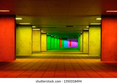 Colorful mulitcolord illuminated gallery tunnel rainbow passage under NAI building, Nederlands Architecture Institute near Museum Park, Rotterdam, The Netherlands
