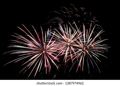 Colorful multi-colored fireworks, salute on the background of the black sky on holiday
