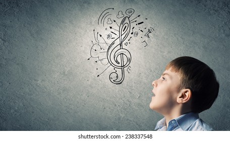 Colorful music symbol and cute boy singing