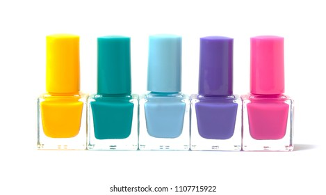 Colorful nail polishes bottles isolated on white. Cut out. Trendy manicure minimalistic concept